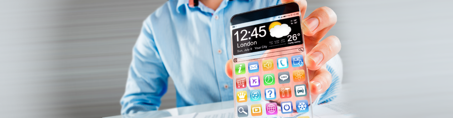 Man holding up mobile phone showing apps